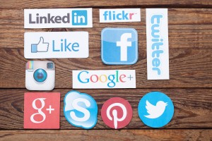 44537940 - kiev, ukraine - august 22, 2015:collection of popular social media logos printed on paper:facebook, twitter, google plus, instagram, pinterest, skype, youtube, linkedin and others on wooden background